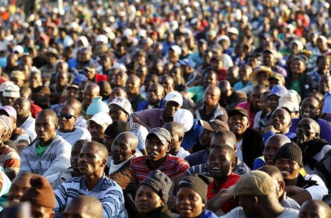 The mining community looks on as they are addressed by their leaders during a strike at Lonmin's Marikana platinum mine in Rustenburg, 100 k