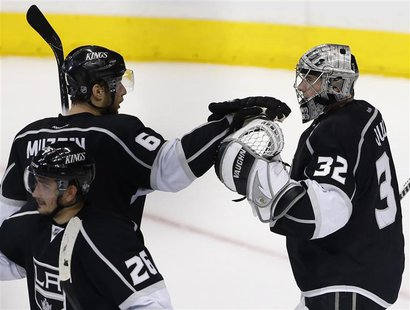 Los Angeles Kings goalie Jonathan Quick (32) celebrates defeating the San Jose Sharks with teammate Los Angeles Kings defenseman Jake Muzzin