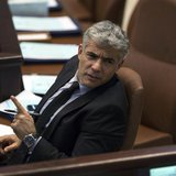 Israel's Finance Minister Yair Lapid gestures as he attends the opening of the summer session of the Knesset, the Israeli parliament, in Jer