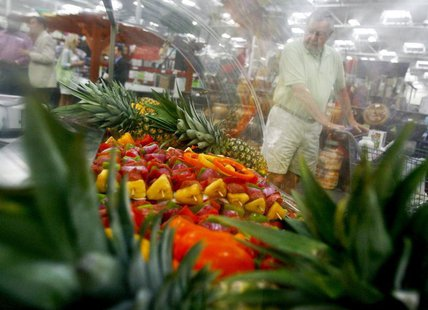 A customer shops along the fruits department in a Sam's Club store, a division of Wal-Mart Stores, in Bentonville, Arkansas June 2, 2011. RE