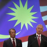Malaysia's Prime Minister Najib Razak (R) speaks as his deputy Muhyiddin Yassin listens during the announcement of the new cabinet ministers