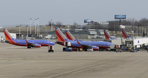 Several Souhtwest Airlines planes are lined up at Terminal two at the Lambert - St. Louis International Airport, in St. Louis, Missouri, Mar