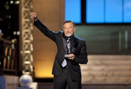 Comedian Robin Williams reacts after receiving the Stand Up Icon Award during the second annual 2012 Comedy Awards in New York April 28, 201
