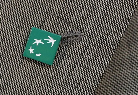 A BNP Paribas bank logo is seen pinned on a jacket during the presentation of the bank's 2012 annual results in Paris February 14, 2013. REU