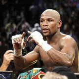 Undefeated WBC welterweight champion Floyd Mayweather Jr. of the U.S. celebrates his victory over Robert Guerrero, also of the U.S., at the