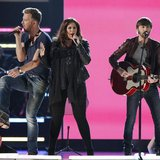 "Charles Kelley (L), Hillary Scott and Dave Haywood of Lady Antebellum perform the song ""Downtown"" during the 48th ACM Awards in Las Vegas Ap"