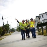 Workers check power lines in Breezy Point, New York September 8, 2012. REUTERS/Eric Thayer