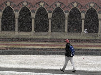 A pedestrian walks through a late winter snow storm outside Harvard University in Cambridge, Massachusetts February 29, 2012. REUTERS/Brian