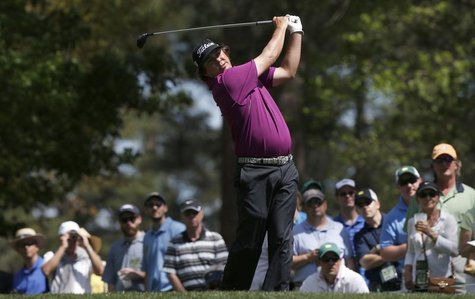 Jason Dufner of the U.S. hits his tee shot on the fourth hole during third round play in the 2013 Masters golf tournament at the Augusta Nat