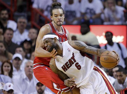 Miami Heat's LeBron James (6) drives past Chicago Bulls' Joakim Noah during the fourth quarter in Game 5 of their NBA Eastern Conference sem