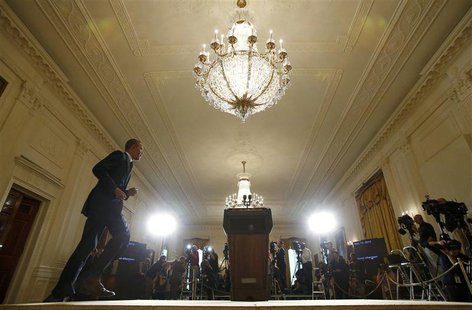 President Barack Obama takes the stage to deliver a statement in the East Room of the White House in Washington, May 15, 2013. REUTERS/Kevin
