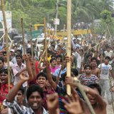Garment workers shout slogans as they block a street during a protest to demand capital punishment for those responsible for the collapse of