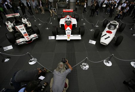 (L-R) The 2006 Honda RA106, 1988 McLaren Honda MP4/4 and 1965 Honda RA272 Formula One cars are displayed at the company headquarters in Toky