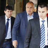The leader of Bulgarian centre-right GERB party Boiko Borisov (C) walks out of his party's headquarters surrounded by bodyguards in Sofia Ma