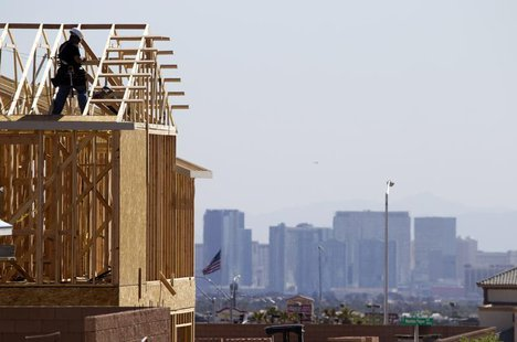 Carpenters work on new homes at a residential construction site in the west side of the Las Vegas Valley in Las Vegas, Nevada April 5, 2013.