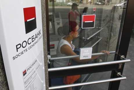 A woman walks out of an office of Rosbank in central Moscow, May 15, 2013. REUTERS/Maxim Shemetov