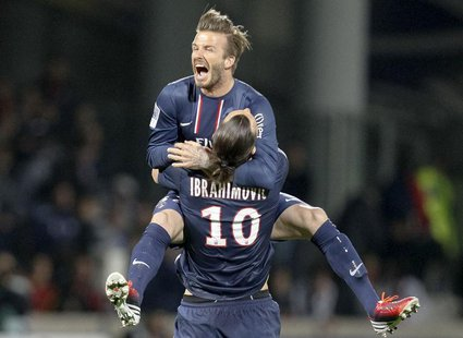 Paris Saint-Germain's Zlatan Ibrahimovic and David Beckham celebrate at the end of their team's French Ligue 1 soccer match against Olympiqu