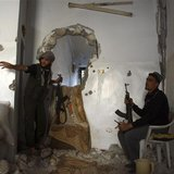 Free Syrian Army fighters take position inside a house in Deir al-Zor May 15, 2013. Picture taken May 15, 2013. REUTERS/Khalil Ashawi