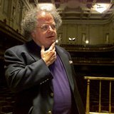 James Levine pauses as he looks over the stage and conductor's podium in Boston's Symphony Hall after being announced as the next conductor