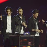 Pop group One Direction react after being awarded the Global Success award at the BRIT Awards, celebrating British pop music, at the O2 Aren