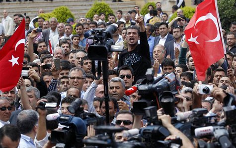 A man shouts as Turkey's President Abdullah Gul talks to people during his visit to one of the two blast sites, which resulted in the deaths