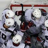 Team USA's players celebrate after defeating Russia in their 2013 IIHF Ice Hockey World Championship quarter-final match at the Hartwall Are