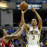 Indiana Pacers guard George Hill (3) shoots the basketball over Atlanta Hawks guard Jeff Teague during the first half of their NBA first rou