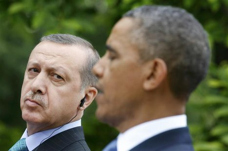 Turkish Prime Minister Recep Tayyip Erdogan (L) listens to U.S. President Barack Obama during a joint news conference in the White House Ros