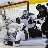 San Jose Sharks Joe Pavelski dives to block the puck in front of goalie Antti Niemi as Los Angeles Kings Dustin Penner (R) looks on during G