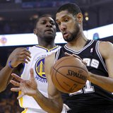 San Antonio Spurs' Tim Duncan (R) takes a rebound from Golden State Warriors' Festus Ezeli during Game 6 of their NBA Western Conference sem