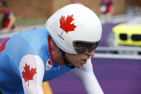 Canada's Ryder Hesjedal competes in the men's cycling individual time trial at the London 2012 Olympic Games August 1, 2012. REUTERS/Mark Bl