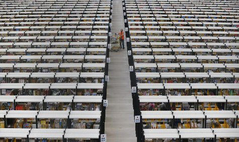 A worker collects orders at Amazon's fulfilment centre in Rugeley, central England December 11, 2012. REUTERS/Phil Noble