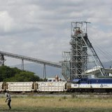 A man walks past a train carrying goods, at Anglo Platinum's Khomanani shaft 1 mine in Rustenburg, northwest of Johannesburg January 15, 201
