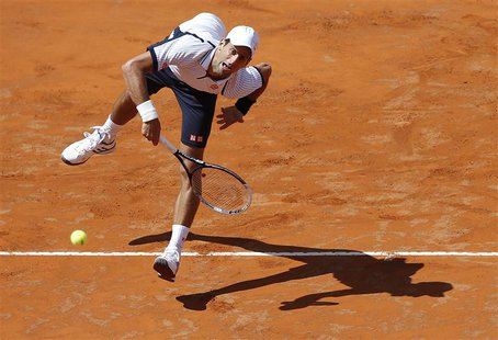Novak Djokovic of Serbia serves to Tomas Berdych of Czech Republic during their men's singles quarter final match at the Rome Masters tennis