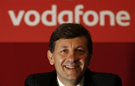 Vodafone's new Chief Executive Vittorio Colao poses for photos after their company's annual general meeting in a conference centre in Westmi