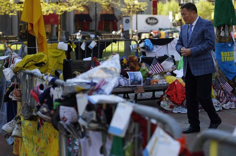Amir Ismagulov, the father of Azamat Tazhayakov, visits the makeshift memorial for the victims of the Boston Marathon bombings in Boston, Ma