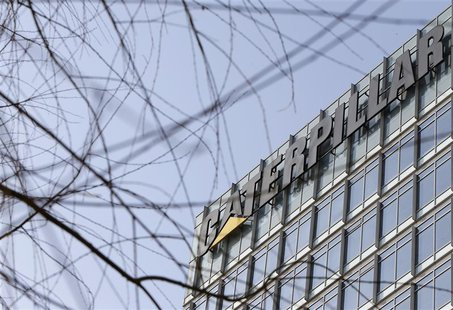 The company logo is seen on top of a building, where Caterpillar (China) Investment Co., Ltd. is located, in Beijing, January 22, 2013. REUT