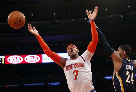 New York Knicks' Carmelo Anthony reacts as he has his shot blocked by Indiana Pacers' Paul George during the second quarter in Game 5 of the