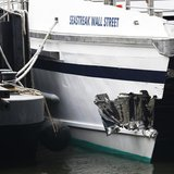 New York City emergency responders investigate a commuter ferry crash that occurred during the morning rush in New York, in this January 9,