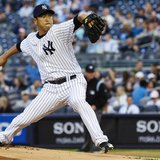 New York Yankees starting pitcher Hiroki Kuroda throws a pitch to the Toronto Blue Jays in the first inning of their MLB American League bas