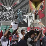 Protesters chant anti-Mursi and anti-Muslim Brotherhood slogans near graffiti during a demonstration in a street leading to Tahrir square, i