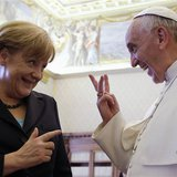 Pope Francis (R) gestures as he talks to German Chancellor Angela Merkel during a private audience at the Vatican, May 18, 2013. REUTERS/Gre