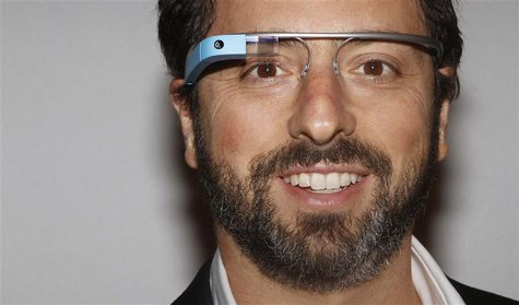 Google founder Sergey Brin poses for a portrait wearing Google Glass before the Diane von Furstenberg Spring/Summer 2013 collection show dur