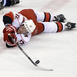 Carolina Hurricanes' Eric Staal (12) passes the puck after falling against the Winnipeg Jets during the first period of their NHL hockey gam
