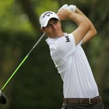 Nicolas Colsaerts of Belgium hits his tee shot on the second hole during first round play in the 2013 Masters golf tournament at the Augusta