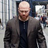 Phoenix Coyotes winger Raffi Torres walks from the NHL offices after meeting with officials in New York April 20, 2012. REUTERS/Keith Bedfor