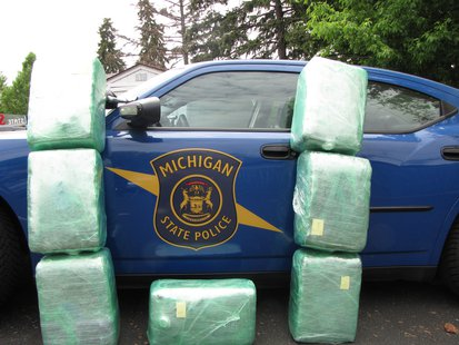 The State Police photo of Pot bales piled up against a cruiser.