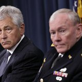 U.S. Secretary of Defense Chuck Hagel (L) and Joint Chiefs of Staff General Martin Dempsey hold a joint news conference at the Pentagon in W