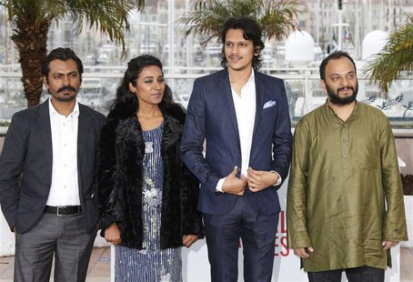 Cast members Nawazuddin Siddiqui, Tannishtha Chatterjee, Vijay Varma and director Amit Kumar pose during a photocall for the film 'Monsoon S