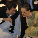 Rahul Gandhi, a lawmaker, speaks to Sonia Gandhi (R), who is his mother and India's ruling Congress party chief, during the Indian National